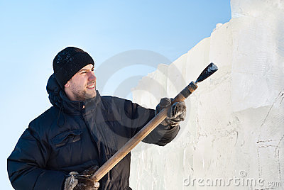 A man cut ice slab