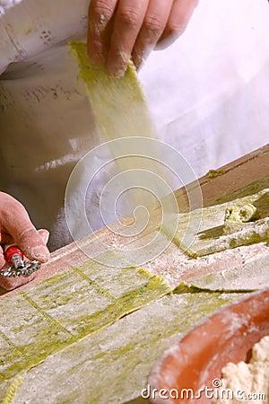 Man cuting pasta