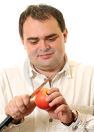 Man cuts an apple