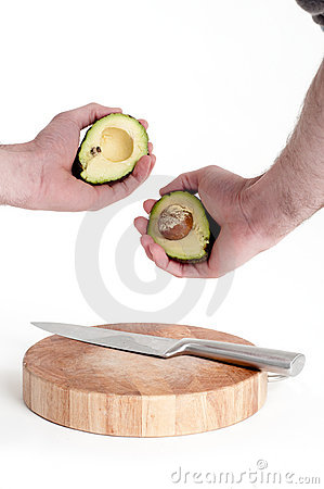 Man cutting avocado
