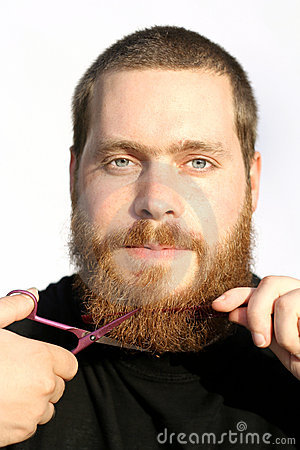 man cutting beard