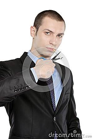 A man cutting a cigarette with scissors