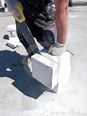 Man cutting concrete block