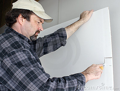 Man cutting drywall