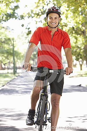 Free Man Cycling Through Park Stock Photos - 55896133