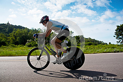 Man  cycling in triatlon Editorial Image
