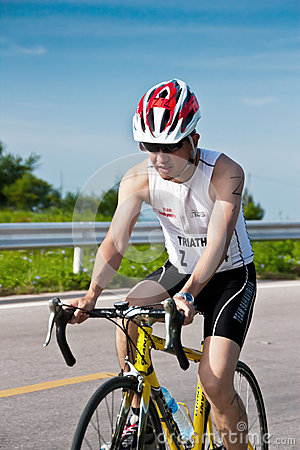Man  cycling in triatlon Editorial Stock Image