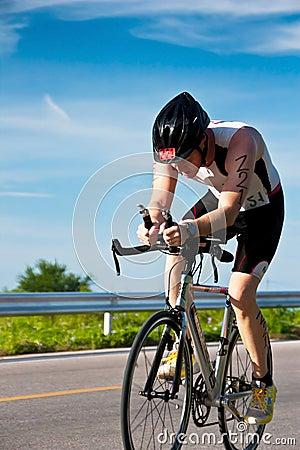Man  cycling in triatlon Editorial Stock Image