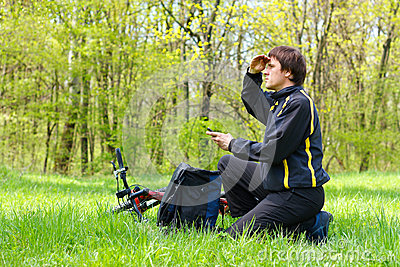 Man cyclist looking for direction of nature