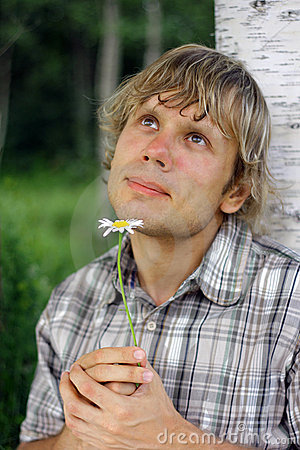 Man with daisy daydreaming