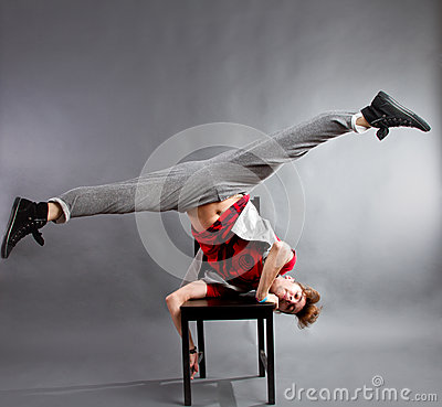 Man dancing on chair