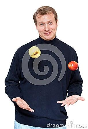 Man in dark cloth juggle apple