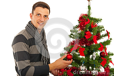 Man decorate Christmas tree