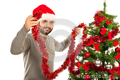 Man decorate Christmas tree