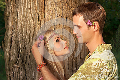 Man decorates hair of beautiful blonde