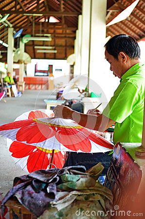 Man decorates umbrella Editorial Image