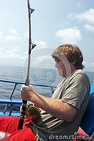 Man deep sea fishing