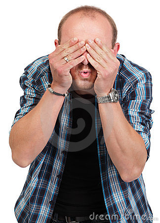 Man in denial covering eyes