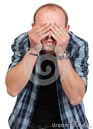 Man in denial covering eyes