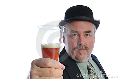 Man in Derby hat holding beer glass