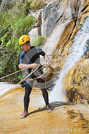 Man Descending Waterfall