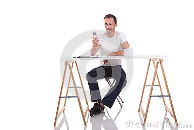 Man at the desk and on the phone