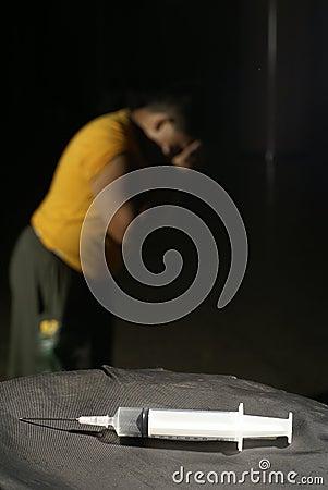 Man in despair with syringe