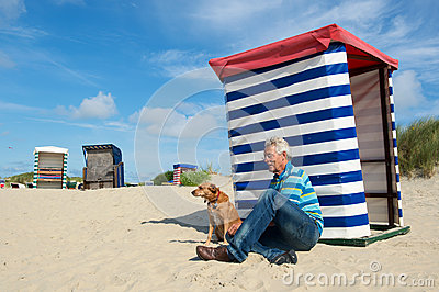 Man with dog at beach Borkum