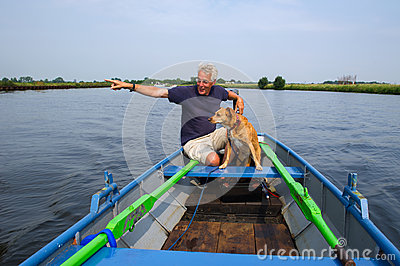 Man with dog in boat