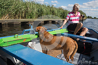 Man with dog in the boat