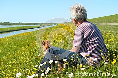 Man and dog on Dutch wadden island Texel