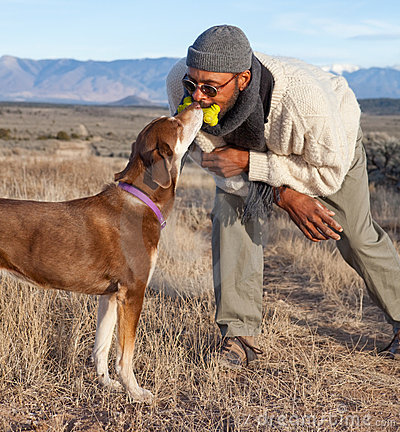 Man and a dog playing