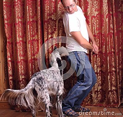 Man and dog playing
