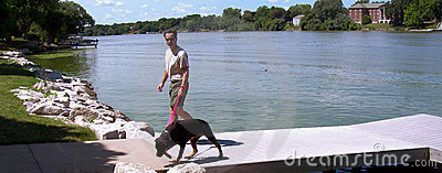 Man and Dog on River Docks
