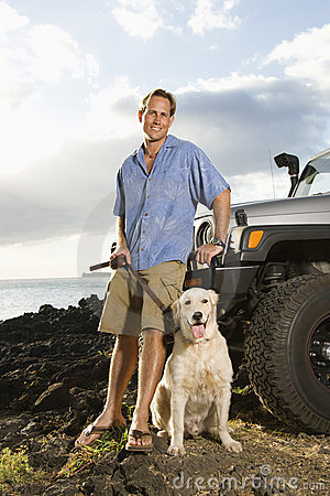 Man and Dog by SUV at the Beach