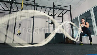Man doing battling rope exercise at the gym. HD video stock footage