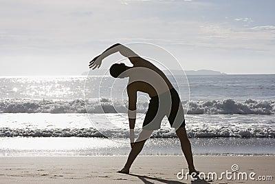 Man doing exercises on beach