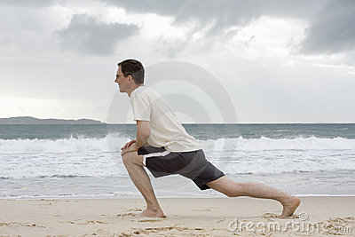 Man doing fitness exercises on a beach