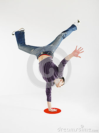 Free Man Doing One Handed Handstand On Red Dot Royalty Free Stock Images - 31830689