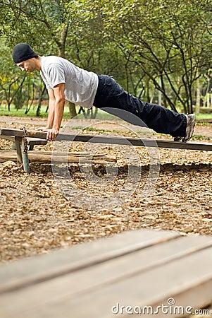 Man Doing Push-ups Outside - vertical