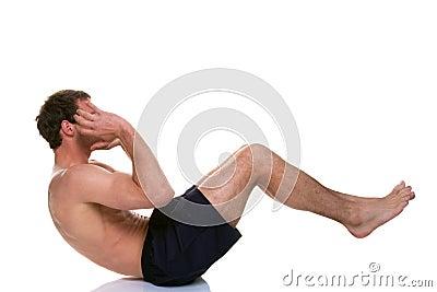 Man doing a sip up stomach crunch