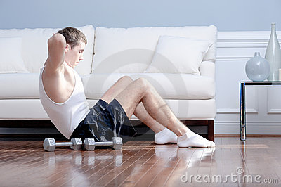 Man Doing Sit-ups in Living Room