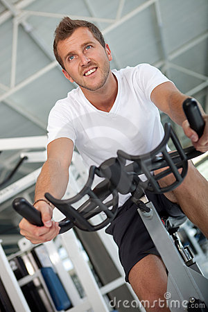 Man doing spinning at the gym