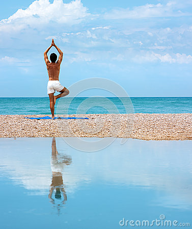 Man Doing Yoga. Vrikshasana Pose (The Tree)