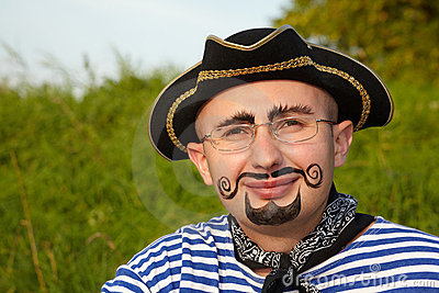 Man with drawed beard and whiskers in pirate suit