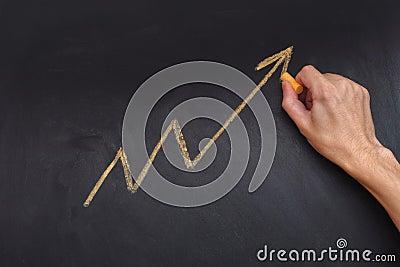 Man drawing yellow arrow showing upward trend and increasing pro Stock Photo