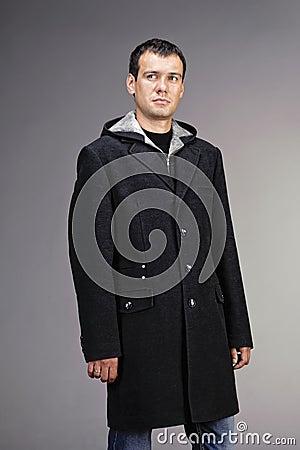 Man dressed in dark gray wool coat Stock Photo