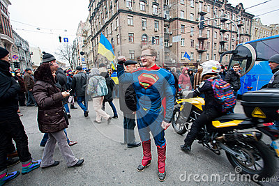 Man dressed in a Superman costume meets anti-government demonstration during the pro-European protest Editorial Photo