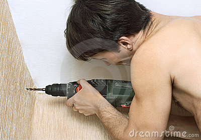 Man with drill. Housework.