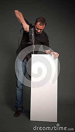 Man drilling a board